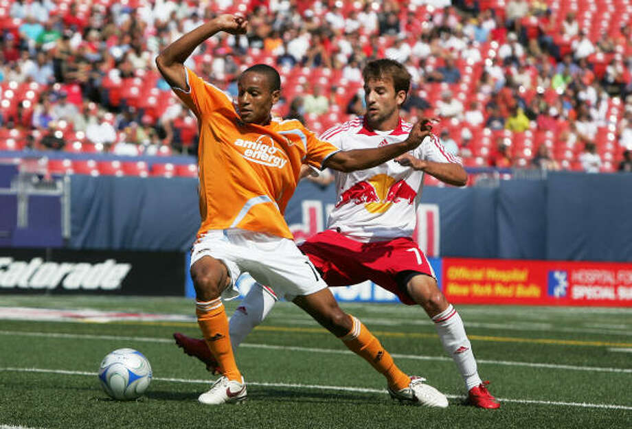 Ricardo Clark battles for the ball against New York's Mike Magee at Giants Stadium in the Meadowlands. Click here for game statistics. Photo: Mike Stobe, Getty Images For New York Red Bu