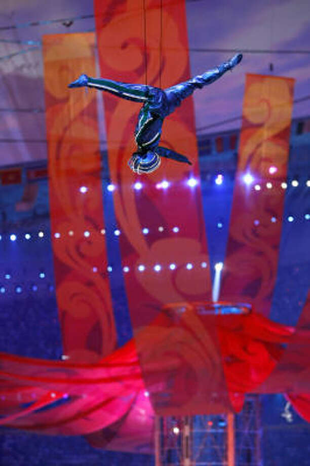Performers dangle high above Nation Stadium during the Closing Ceremony. Photo: Michael Macor, Chronicle Olympic Bureau