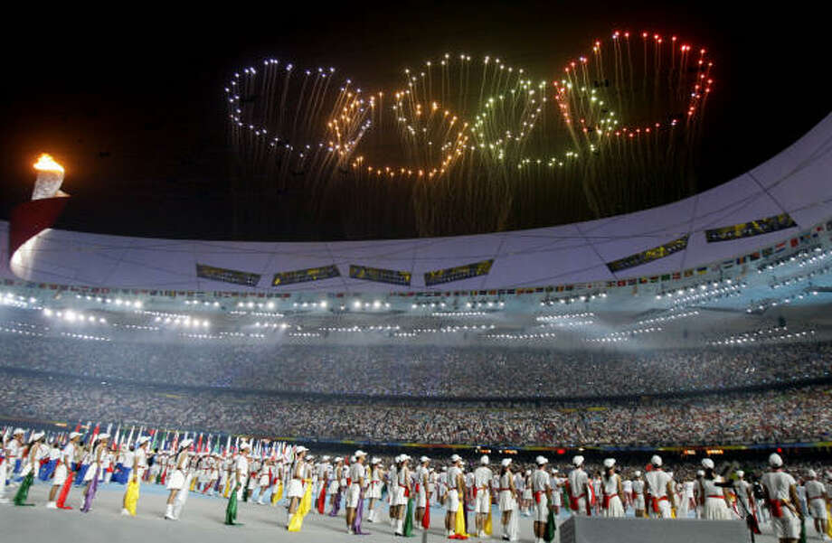 FILE-- Fireworks in the shape of the Olympic rings are launched over National Stadium during the closing ceremony of the 2008 Olympics in Beijing. Photo: Darron Cummings, AP