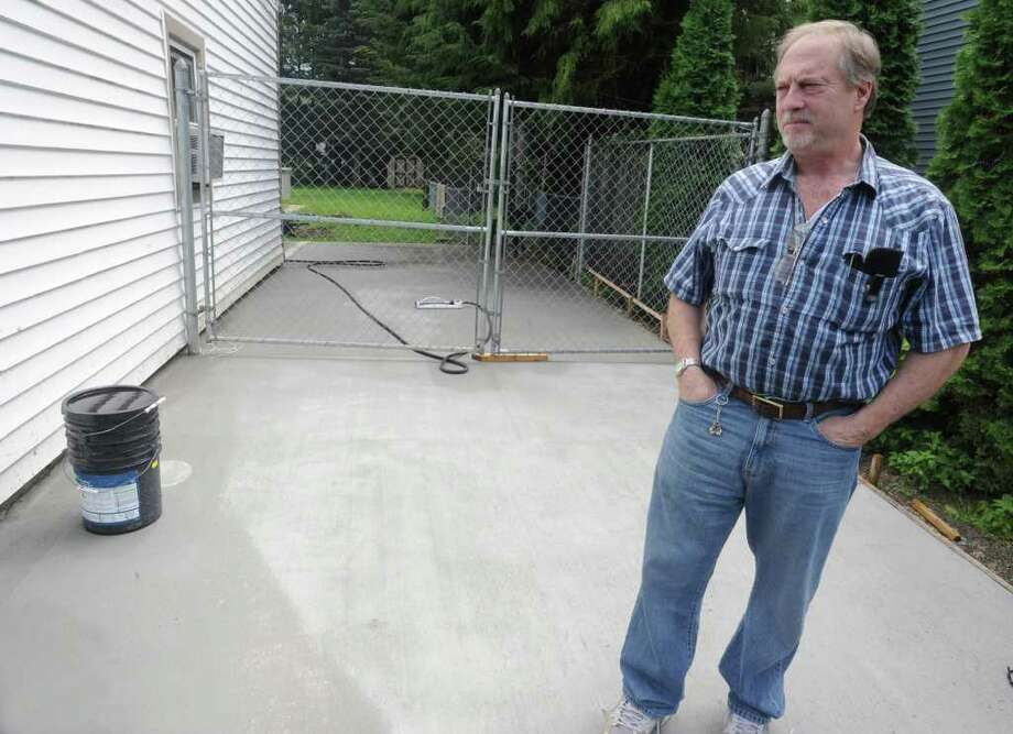 Rich Casullo stands in his driveway at his home in Charlton, N.Y. on Monday, Aug. 8, 2011. A contractor who was supposed to do the concrete job walked away after accepting half the cost and Casullo had to hire another company to finish the job. (Lori Van Buren / Times Union) Photo: Lori Van Buren