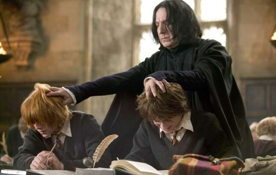 Rupert Grint, from left, as Ron Weasley, Alan Rickman as Severus Snape and Daniel Radcliffe as Harry Potter starred in the film Harry Potter and the Goblet of Fire. Photo: Murray Close, WARNER BROS.