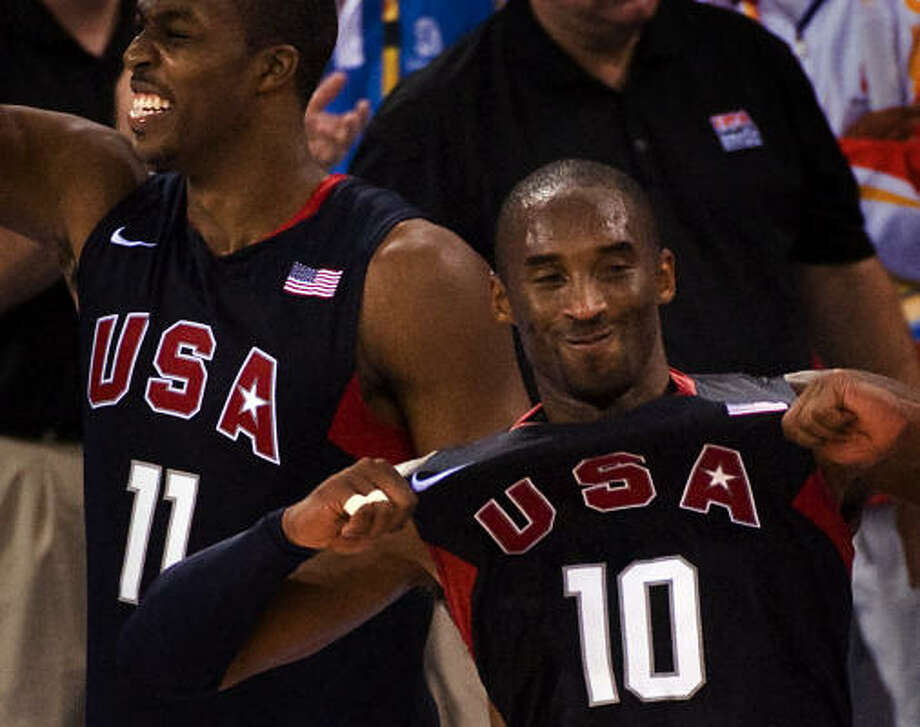 USA beats Spain, 118-107: Kobe Bryant, front, and Dwight Howard celebrate the U.S.'s first gold-medal win since 2000 on Sunday. Photo: Smiley N. Pool, Chronicle Olympic Bureau