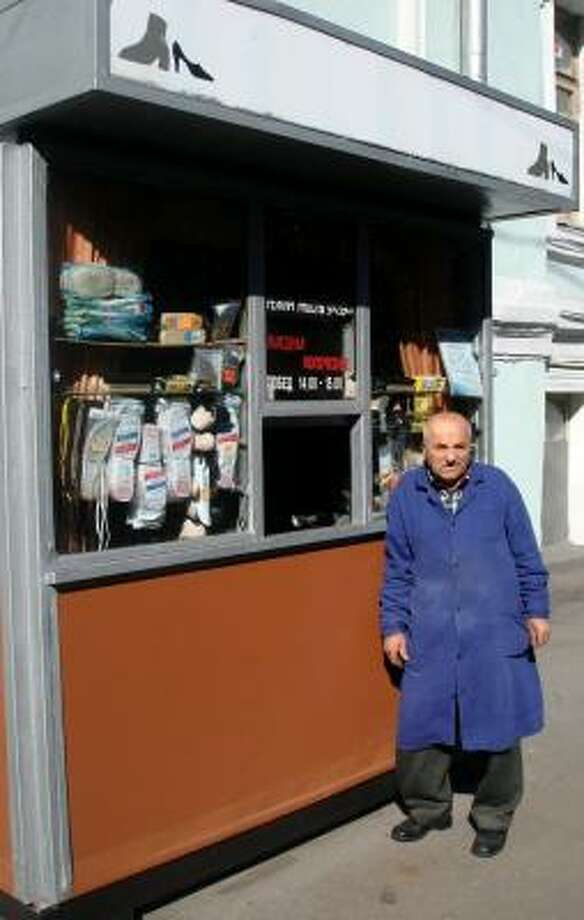 As Moscow's mayor closes down the city's kiosks, a family tradition of shoe repair is threatened. Cobbler Yevgeny Yivo, 76, learned the trade from his father, an Assyrian Christian immigrant. Photo: PETER FINN, WASHINGTON POST