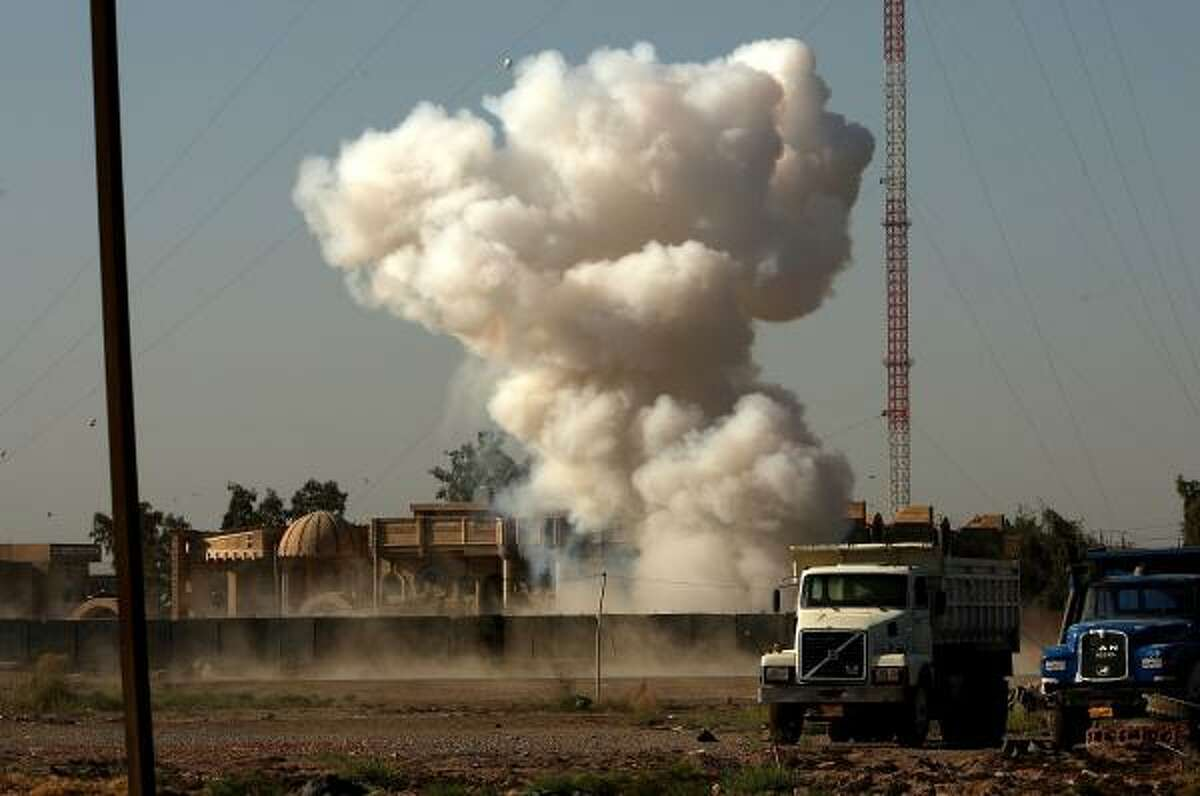 A cloud rises from the Ghazaliya neighborhood in Baghdad after an IED is detonated.