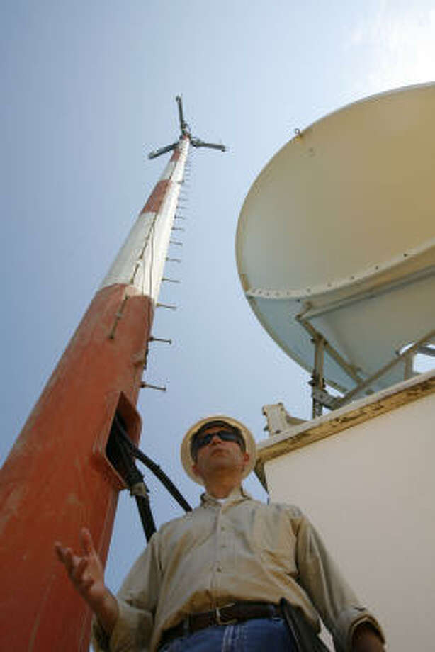 Broadpoint CEO Errol Olivier stands near one of the company's cellular towers out in the Gulf of Mexico. Photo: James Nielsen, Chronicle
