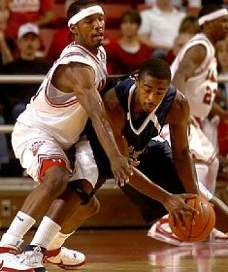 Rodney Foster (in blue) had nine points in 38 minutes for Rice. Photo: Tammy McKinley, Beaumont Enterprise