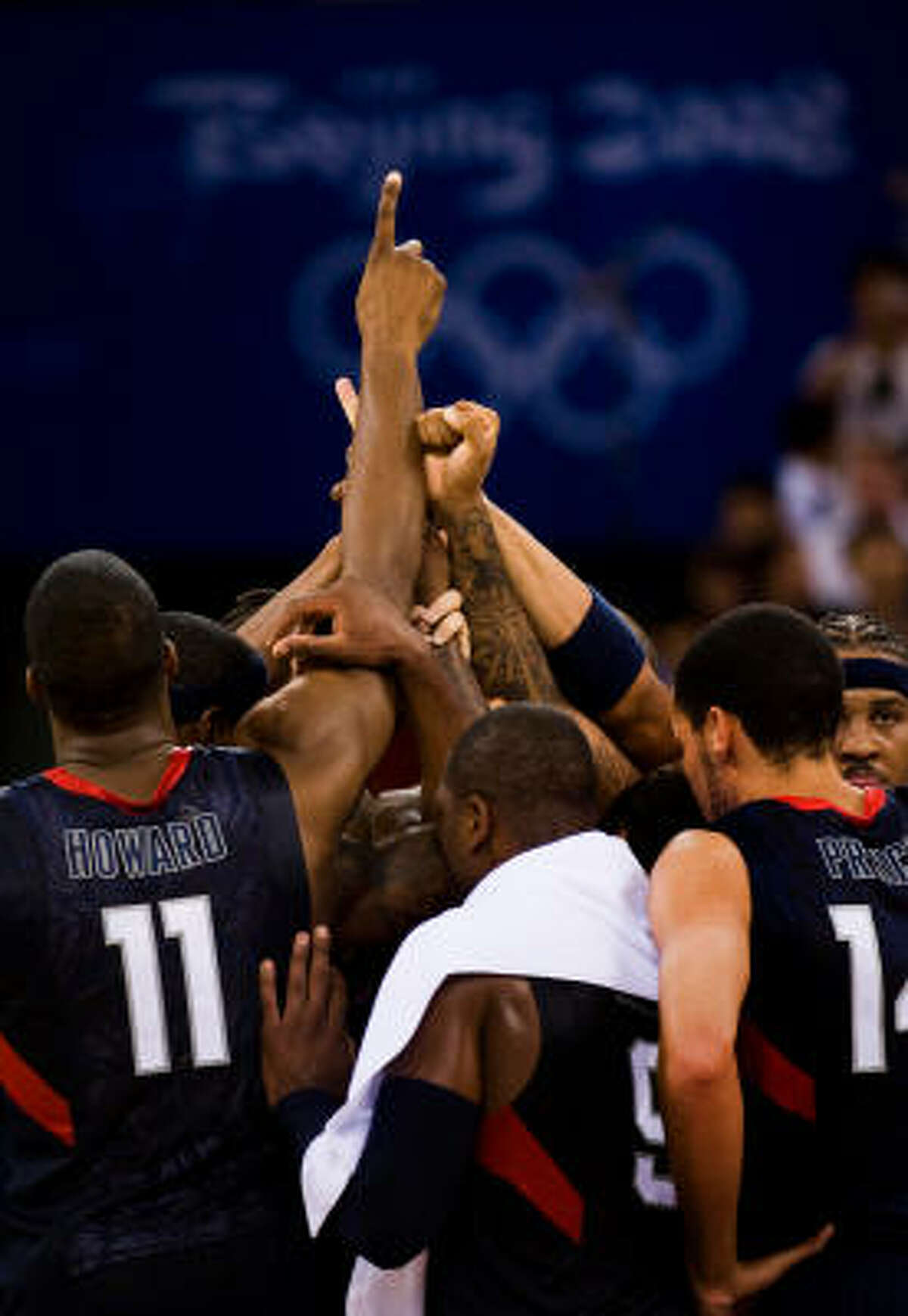Team USA players huddle at center court after defeating Argentina 101-81 to advance to the gold medal game.
