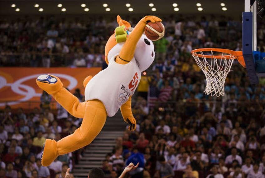 A Beijing 2008 Olympics mascot dunks the ball during a timeout.