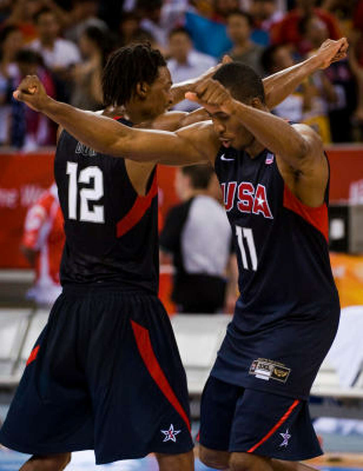 Dwight Howard (11) and Chris Bosh celebrate after defeating Argentina to advance to the gold medal game.