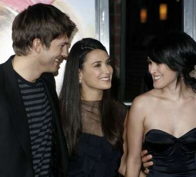 Rumer Willis, right, her mother, Demi Moore, center, and Ashton Kutcher pose together at the premiere of The House Bunny in Los Angeles on Wednesday, Aug. 20, 2008. Photo: Matt Sayles, AP