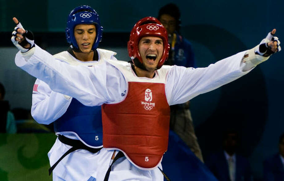 Mauro Sarmiento of Italy celebrates his victory over Steven Lopez of Sugar Land in a taekwondo semifinal in Beijing. A U.S. protest of the outcome was disallowed. Photo: Smiley N. Pool, Chronicle