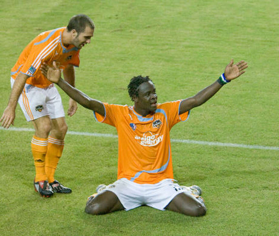 Dynamo forward Kei Kamara, right, scored a goal in the second half of his team's 4-0 win over Chivas USA on Wednesday night at Robertson Stadium. Photo: Steve Campbell, Chronicle