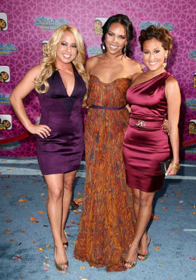 Sabrina Bryan, from left, Kiely Williams and Adrienne Bailon of the Cheetah Girls arrive at the premiere of Disney Channel's The Cheetah Girls One World on Aug. 12. Photo: Alberto E. Rodriguez, Getty Images