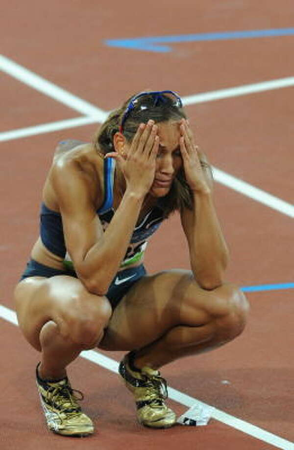 "Year: 2008. Who: U.S. track team. The flop: Failure to get gold for Lolo Jones (above) and others. What Blinebury says: ""The wreckage of U.S. track and field can be found all over the Bird's Nest."" Photo: WILLIAM WEST, AFP/Getty Images"