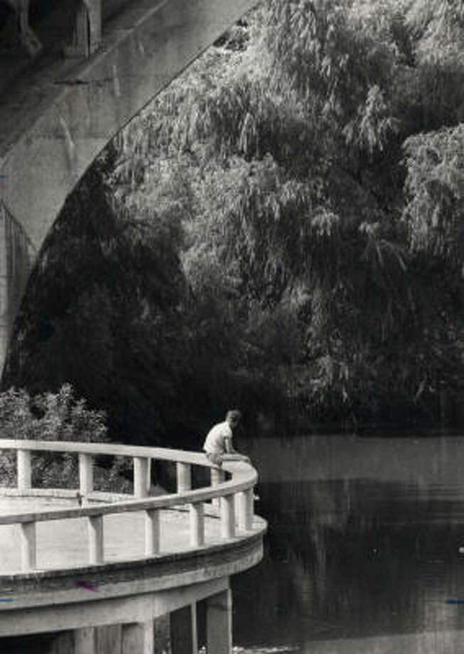 A lone visitor enjoy the sights from Allen's Landing. Photo: Chronicle File