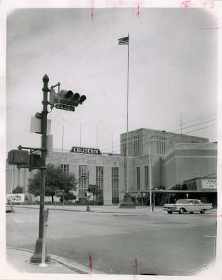 Sam Houston Coliseum. The pole is still a memorial to the individuals who served in WWI and the colors are still flying. It was erected in 1919 at Main and McKinney, but in 1927 was moved to the Sunken Gardens on South Main. However, so many motorists ran their cars into the pole in the Sunken Gardens that in 1936 it was moved downtown and placed in front of the Music Hall. Photo: Houston Chronicle