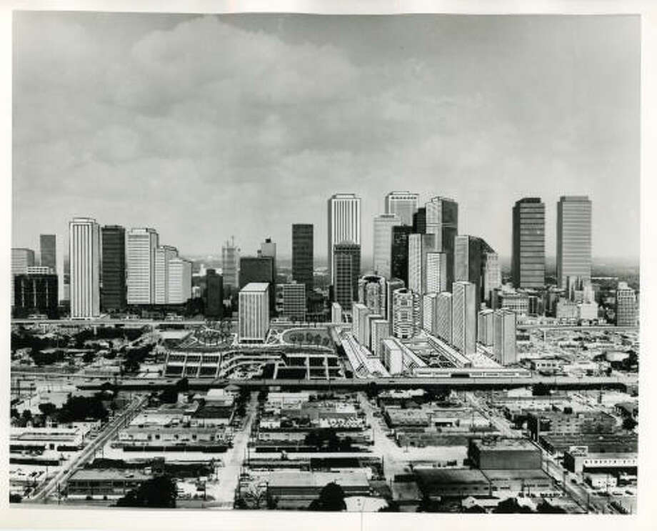This artistic interpretation of new buildings to be added to downtown Houston by the year 2000 (looking west across the Eastex Freeway) was adapted from information obtained by Post real estate writer Carl Hooper and Post Business Editor Gerald Egger from various sources around the United States. In all likelihood, new skyscrapers in addition to those shown here, will be designed and constructed during the next two decades. Also, a number of questions remain as to what type of mass people-moving facilities - if any - will be available. However, a number of the buildings added to the current skyline are in planning stages or already under construction. Post sketch by Bud Bentley. Photographer: Fred Bunch