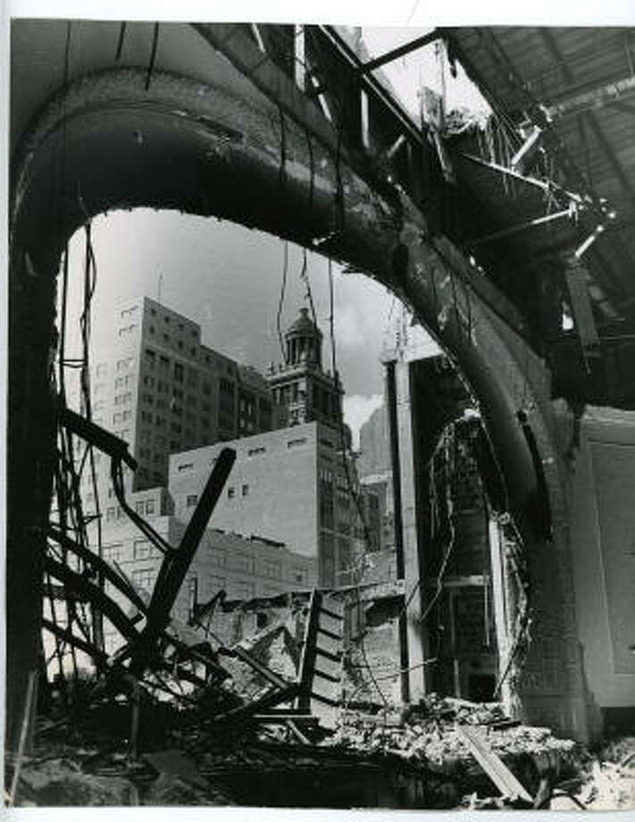 A 1963 image of the city auditorium's once-picturesque proscenium. It stands amidst debris as the Olshan Demolishing Co. Inc. takes it down. The 53-year-old building at Texas and Louisiana wasbeing cleared to make way for the Jesse H. Jones Hall for the Performing Arts, a $6 million donation to the city by Houston Endowment Inc. Clearance was reportedly slow because the old building was so well constructed. The auditorium housed such artists as Paderewski, ballerina Pavlowa, and tenor Caruso. In more recent years, wrestlers and road shows performed in the $500,000 building. Photo: TOM COLBURN, HOUSTON CHRONICLE