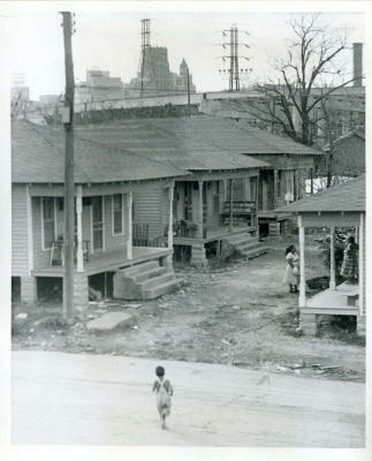 East side of Downtown Houston in the same immediate area as the Susan V. Clayton Homes is one of Houston's run down, low rental districts. This photo was taken near the 600 block of Raines Street in 1956 or 1957. Photo: UNKNOWN, HOUSTON CHRONICLE