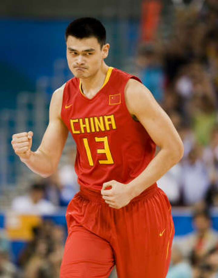 Yao Ming celebrates after sinking the first basket of the game, an uncharacteristic 3-pointer, against Team USA. Yao finished with 13 points. Photo: Smiley N. Pool, Chronicle