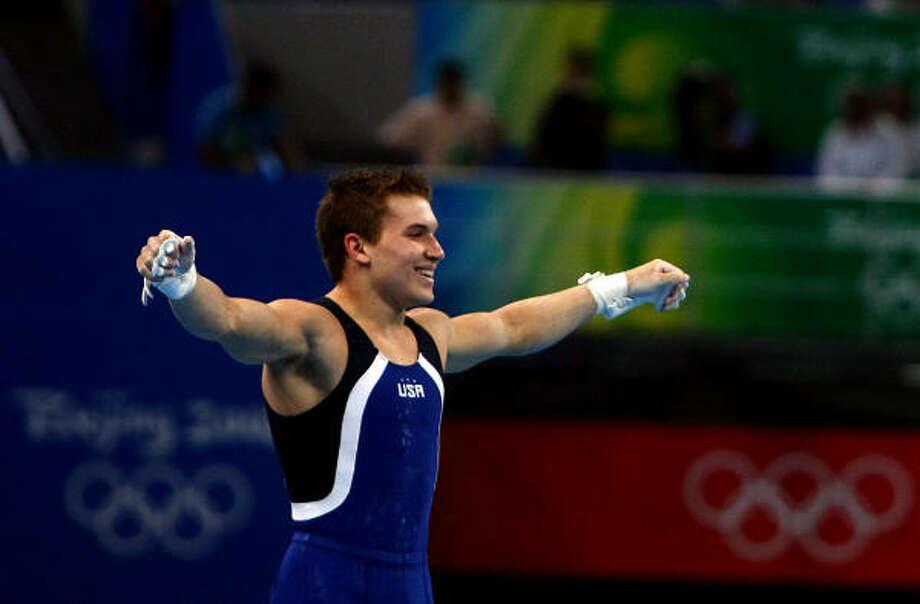 El gimnasta houstoniano Jonathan Horton reacciona luego de completar su rutina del martes por la cual ganó otra medalla de plata en los Juegos Olímpicos de Beijing. Photo: Jonathan Ferrey, Getty Images