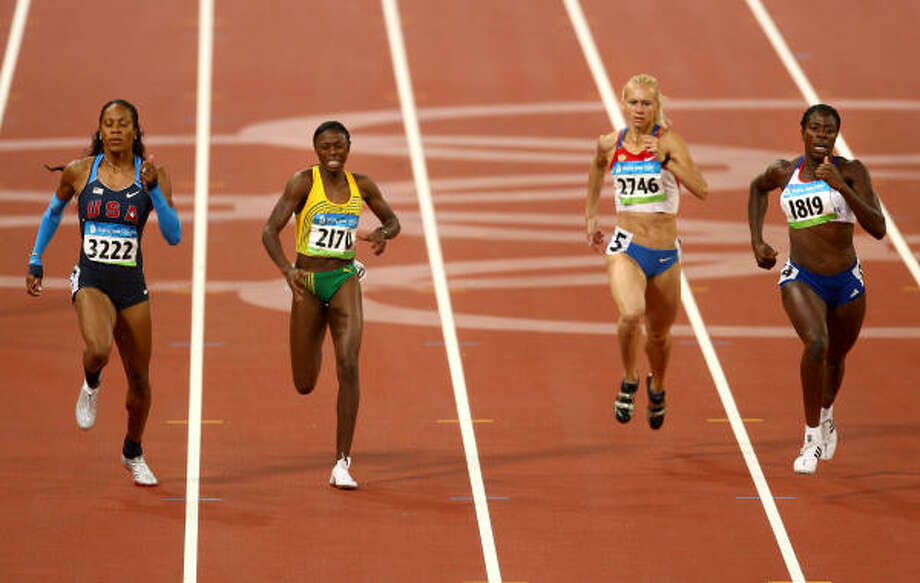 Sanya Richards (left) of the United States, who entered the race with expectations of gold, crosses the line in the women's 400-meter Final held at the National Stadium for a bronze medal. Photo: Michael Steele, Getty Images