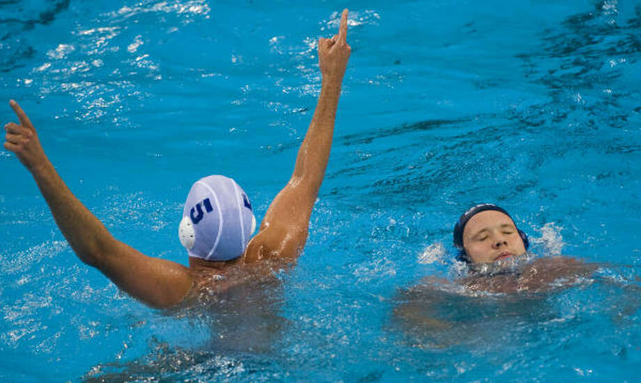 The United States is going to play for a medal in water polo for the first time in 16 years. Adam Wright (5) had a goal Tuesday in an 8-7 win over Germany that pushed Team USA into the semifinal round. Photo: Smiley N. Pool, Chronicle