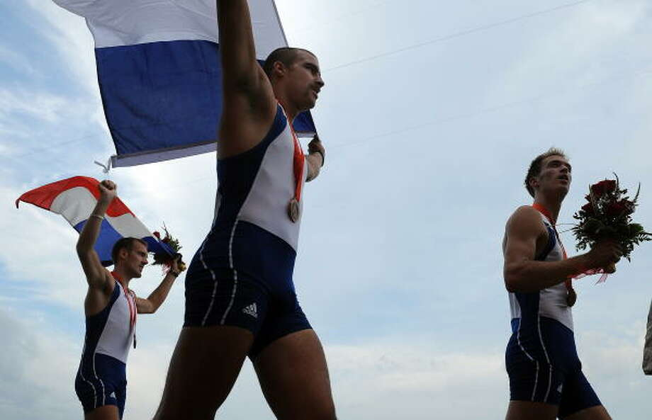 Aug. 16, 2008: French rowers celebrate at Shunyi Rowing and Canoeing Park in Beijing. The French team had a nice day for weather and won a bronze medal to boot. Photo: FRED DUFOUR, AFP/Getty Images