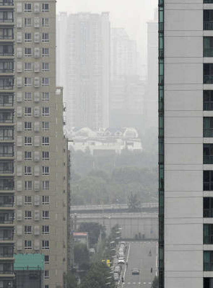Aug. 13, 2008: Here's a view of downtown Beijing. The Chinese government is reported to have spent $12.2 billion in an effort to reduce pollution. Photo: PHILIPPE HUGUEN, AFP/Getty Images