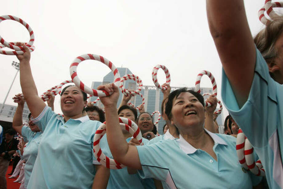 Aug. 6, 2008:  The people of Beijing welcome the torch relay. Photo: AFP, AFP/Getty Images