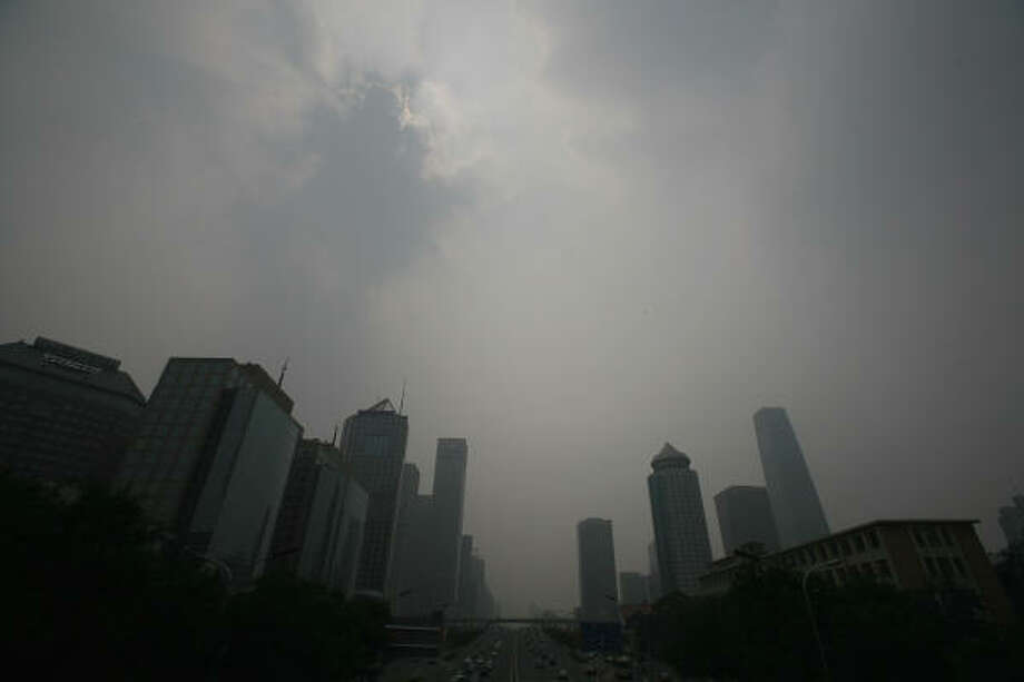 July 28, 2008:A general view of the Central Business District which is shrouded with heavy smog. Pollution levels remained high just 11 days before the Olympics. The Chinese capital could ban 90 percent of private cars from its roads and closing more factories in a last-ditch bid to clear smoggy skies for the Olympics. Photo: Andrew Wong, Getty Images