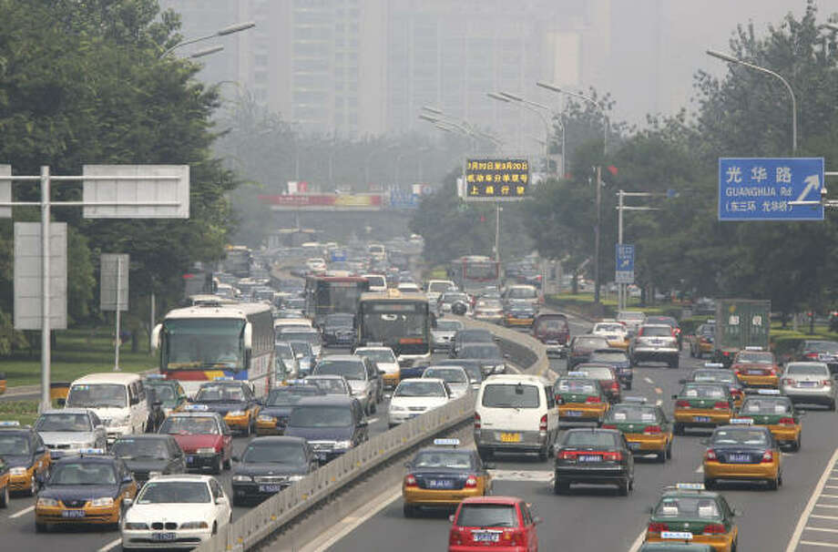July 21, 2008:Cars drive on Beijing's Second Ring Road under hazy skies. Morning haze hung over Beijing on Monday, the first workday for restrictions on car use under a bold plan to clear the Olympic city of its notorious smog-choked skies. Photo: Greg Baker, AP