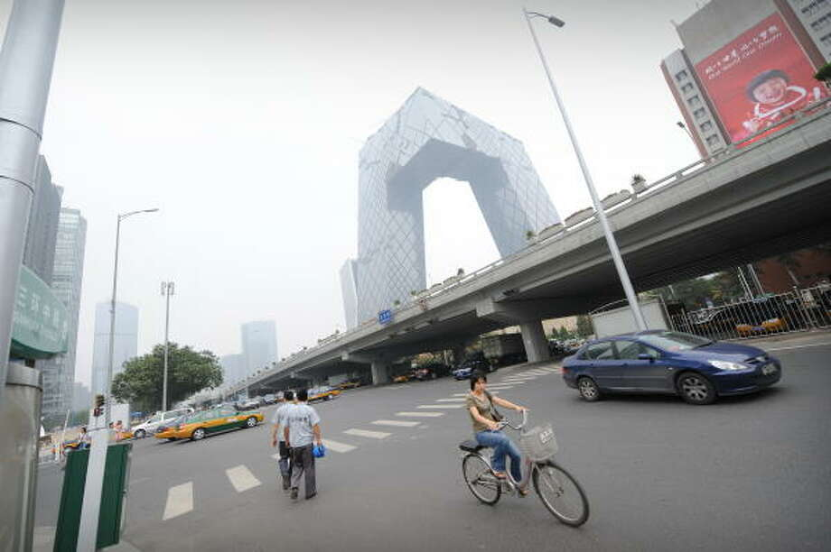 July 10, 2008: Traffic passes through a busy intersection in Beijing. Photo: PETER PARKS, AFP/Getty Images