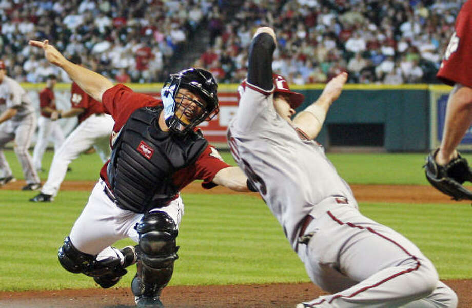 Astros catcher Brad Ausmus tags out Diamondbacks' Chris Snyder at the plate during the third inning. Photo: Kevin M. Cox, AP