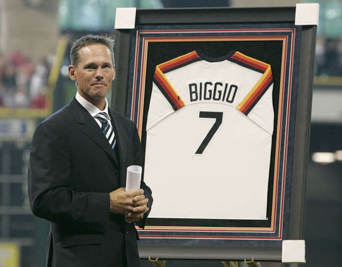 Former Astros player Craig Biggio stands next to his jersery at his number retirement ceremony before a baseball game between the Astros and the Arizona Diamondbacks.