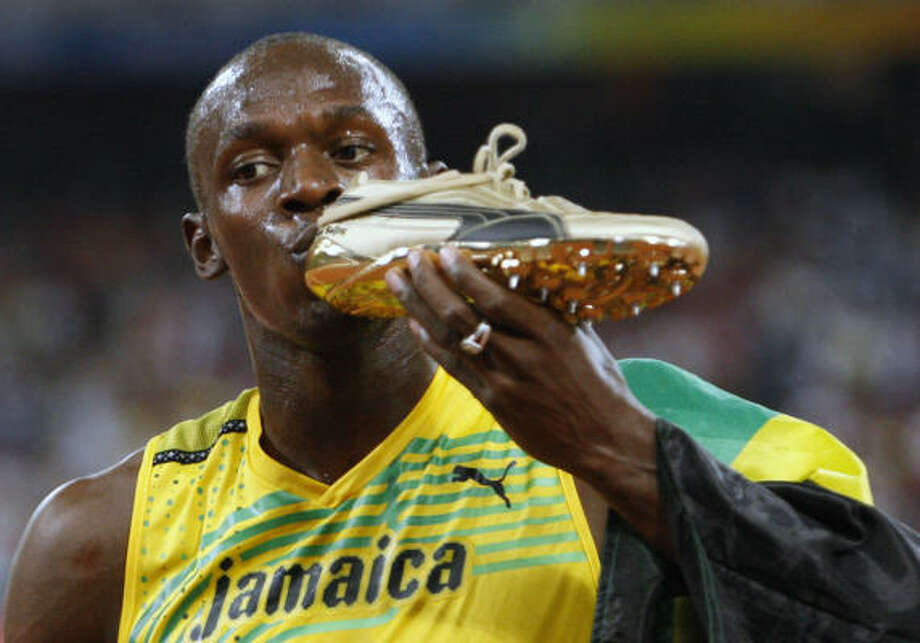 "Usain Bolt of Jamaica won gold in the men's 100 meters Saturday night with a world-record time of 9.69 seconds. He bettered his own mark and retained the unofficial title of ""world's fastest man."" Photo: Robert F. Bukaty, AP"