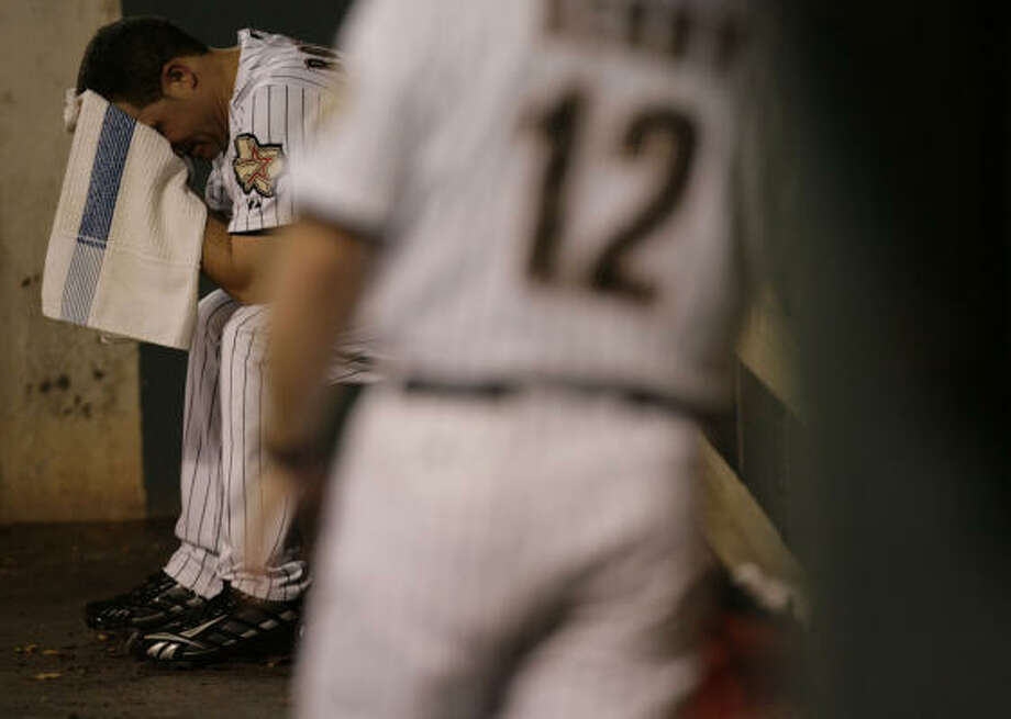 THIRD INNING: Astros pitcher Wandy Rodriguez wipes sweat after he got pulled from the game. Photo: Julio Cortez, Chronicle