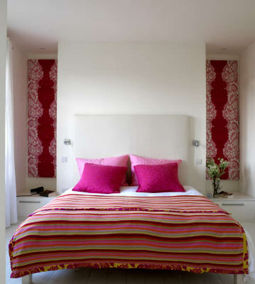 Bed linens are an easy way to coordinate different patterns in a room. This photo, from Easy Cottage Style (Cico Books, $29.95), illustrates a vibrant blend of paisley, stripes and flowers. Photo: Www.simonbrownphotography.com, Simon Brown