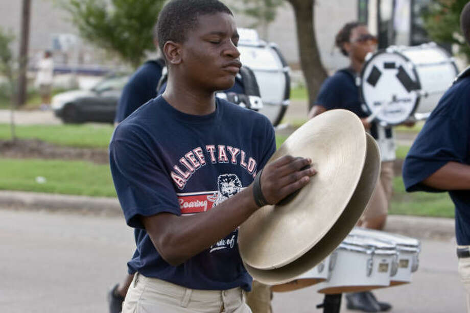 PARADE, FESTIVAL, BOWLING:Hakeem Wilson of the Taylor Roaring Lions marches in the Alief Community Association's first Alief International Parade. Photo: R. Clayton McKee, For The Chronicle