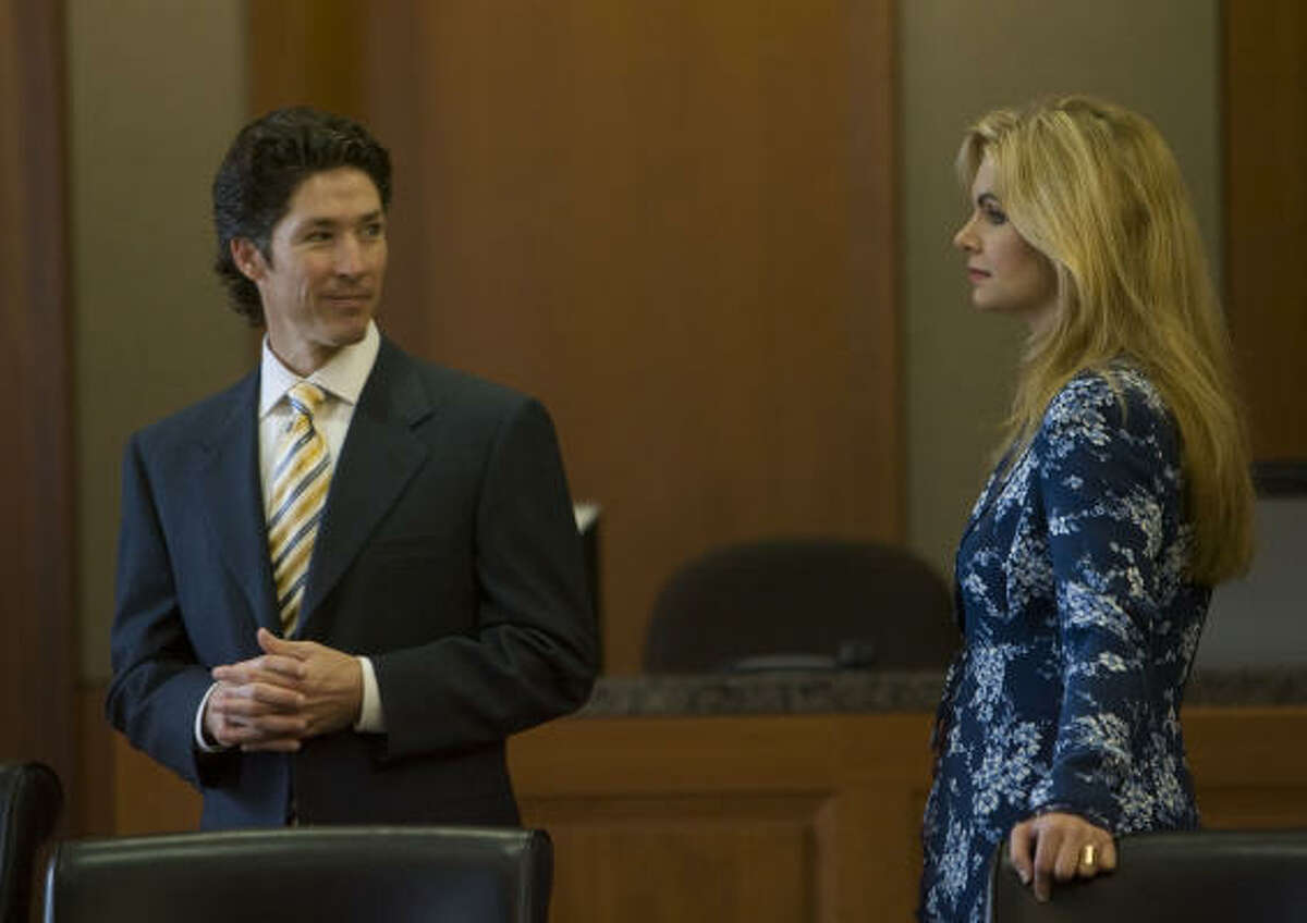 Victoria Osteen (right) and her husband Joel Osteen (left) an at the Harris County Civil Courts at Law building for jury selection on Wednesday.