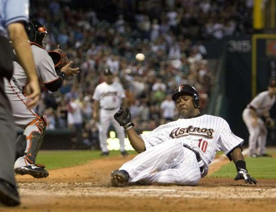 Astros shortstop Miguel Tejada scores on a sacrifice fly to center field by Reggie Abercrombie in the sixth inning of Wednesday night's game against the San Francisco Giants at Minute Maid Park. The Astros scored six runs in that frame and held on for a 6-2 win. Photo: Bob Levey, AP
