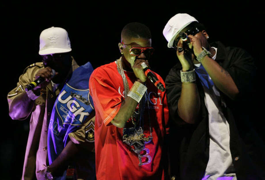 Houston singer Billy Cook, left, and Louisiana rappers Lil Bosie and Webbie perform during a multi-act tribute to the late Pimp C during the third annual Ozone Awards, Monday at the George R. Brown Convention Center. Photo: Julio Cortez, Chronicle