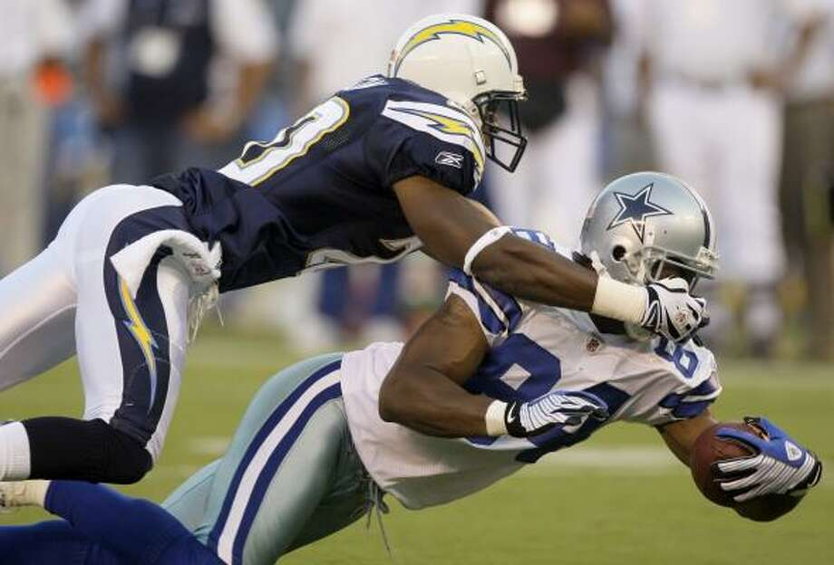 San Diego 31, Dallas 17: Chargers cornerback Antoine Cason, left, brings down Cowboys receiver Patrick Crayton during the first half. Photo: Chris Carlson, AP
