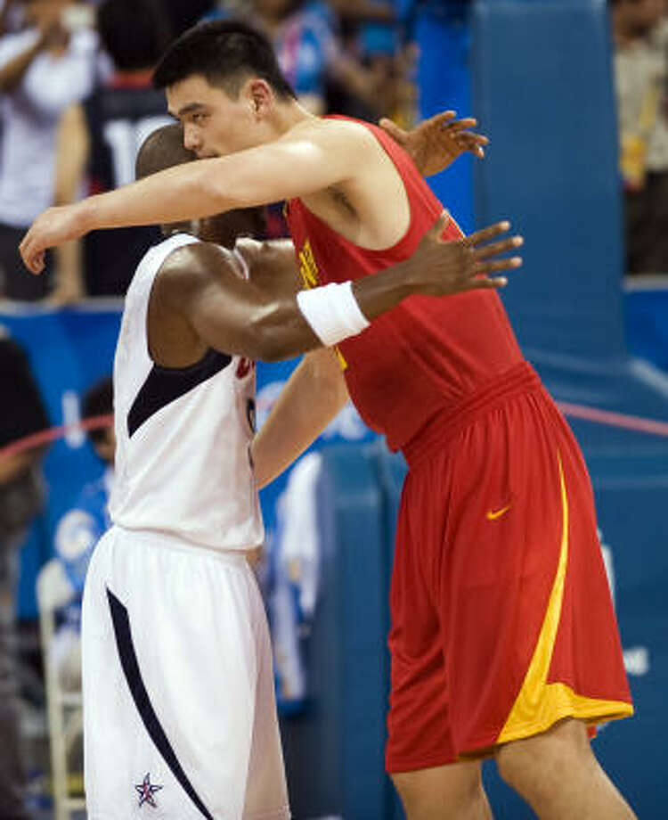 Yao Ming hugs leading scorer Dwayne Wade after Team USA's victory. Photo: Smiley N. Pool, Chronicle Olympic Bureau