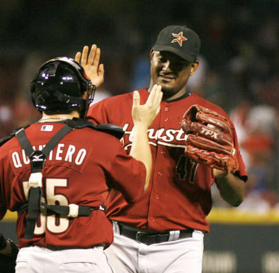 Astros closer Jose Valverde, right, retired the Cincinnati Reds in order in the bottom of the ninth to preserve the Astros' 3-1 win Saturday night in Cincinnati. Photo: David Kohl, AP