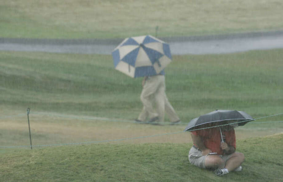 Under a heavy storm, the course at Oakland Hills club is evacuated during the third round. Photo: Mel Evans, AP