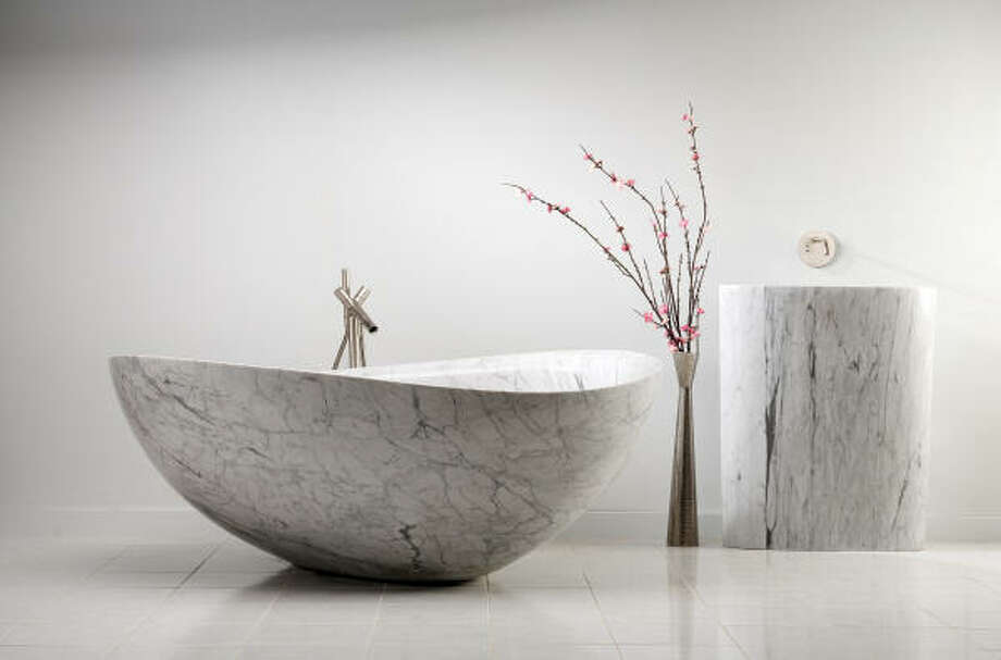 A tub like this one can double as art. Stone Forest Papillon Bathtub in carrara marble, $23,000, Westheimer Plumbing & Hardware and Hollywood Builders Hardware; price to the trade, Elegant Additions. Photo: Eric Swanson, Stone Forest