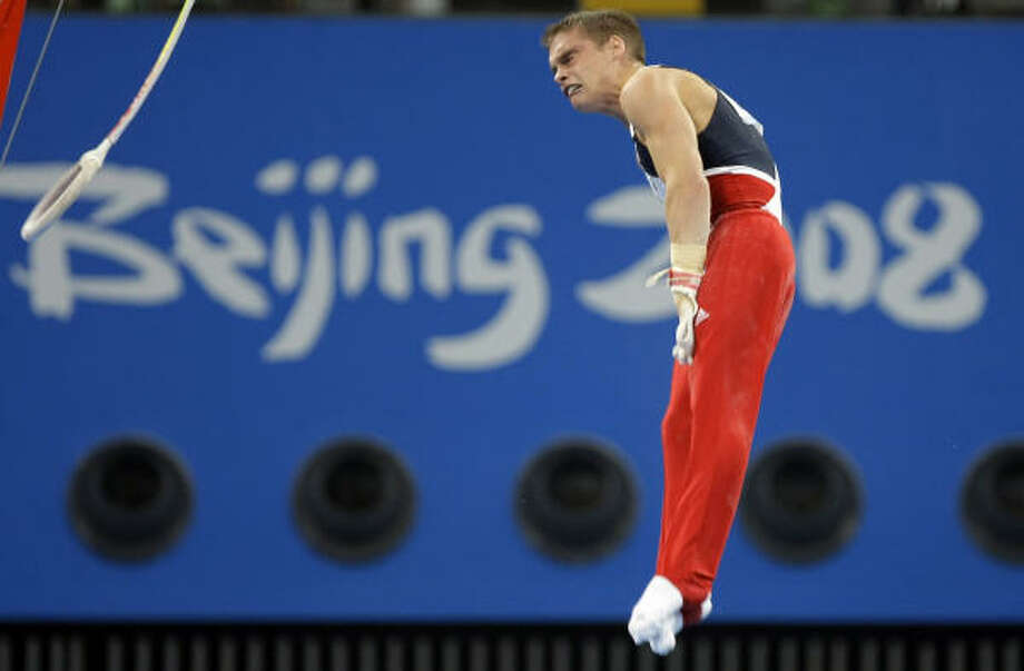 U.S. gymnast Alexander Artemev performs at the rings at the Beijing 2008 Olympics in Beijing, Saturday. Photo: Matt Dunham, AP