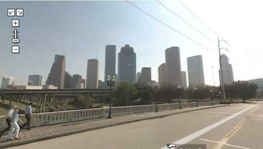 The Houston skyline rises before the Google Maps Street View vehicle as it crosses the Sabine bridge over Buffalo Bayou. Photo: Google