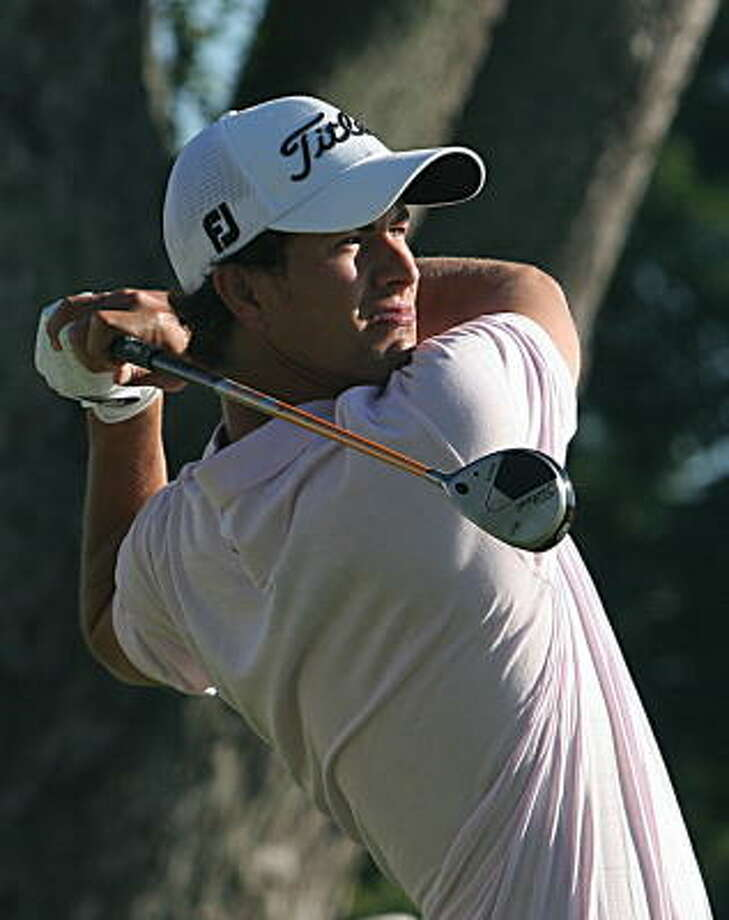 Adam Scott hits his tee shot on the 10th hole. Photo: KAREN BLEIER, AFP/Getty Images